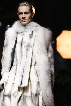 "Val the wildling was clad all in white; white woolen breeches tucked into high boots of bleached white leather, white bearskin cloak pinned at the shoulder with a carved weirwood face, white tunic with bone fastenings.  "" Lanvin, Fall 2014 RTW  """