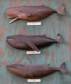 Carved Wooden Whales Mounted on Board