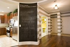 Awesome magnetic/chalkboard wall + gray and white stripes