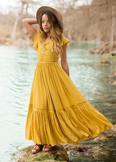 This gorgeous maxi dress features a beautifully soft mustard rayon and full, tiered skirt. The bodice is embellished with a beautiful lace panel and accented crochet trim throughout. Center back invisible zipper. Little Girl Dresses, Girls Dresses, Flower Girl Dresses, Dress Outfits, Girl Outfits, Fashion Outfits, Tween Fashion, Girl Fashion, Tween Mode