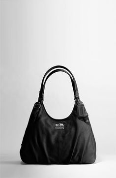 Coach... I've been wanting a plain black bag for the longest! This is kinda the style I had in mind