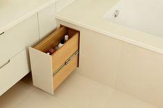 use that dead space, bathtub drawer