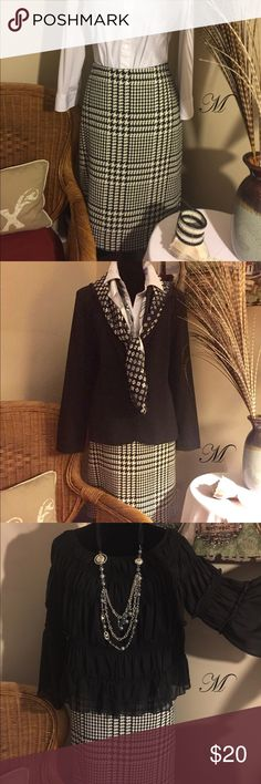 Liz Claiborne Wool Pencil Skirt This part wool houndstooth skirt is a must-have staple for any wardrobe. It is made of 44% polyester, 32% acrylic, 13% wool and 7% rayon, as well as 4% other fibers. The lining is 100% polyester. Liz Claiborne Skirts Pencil