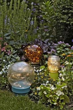 Repurposed glass lamp globes and base exude sparkling charm in the garden after sunset thanks to a string of LED mini lights. Find a light set that includes a remote control for ease of turning your lights on after the sun goes down.