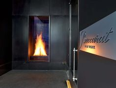 This two-sided, four-foot high fireplace burns 24-7 to represent the furnaces at the Baccarat manufacturing facilities in France.