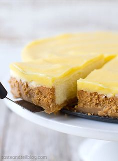 Creamy and rich, this Lemon Cheesecake has a cookie crust and is topped with a tart lemon curd. Not gorgeous to look at but the best cheesecake I've ever had. Would bake at 350 instead of 325 or for an extra mins. Lemon Cheesecake Recipes, Lemon Desserts, Lemon Recipes, Just Desserts, Sweet Recipes, Dessert Recipes, Dinner Recipes, Easter Recipes, Cookies Et Biscuits