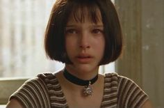 Natalie Portman at in her first movie 'Leon the Professional' . Her acting raises emotions in us.