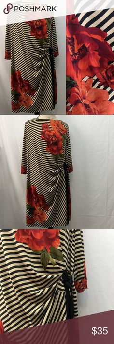"""Shelby & Palmer Dress Shelby & Palmer Floral striped dress. Excellent condition with no flaws. Size 2X. Armpit to armpit 24"""". Shoulder to bottom hem 37"""". Contains 5% spandex so there is stretch. Black/tan stripe with red/orange flowers. Shelby & Palmer Dresses"""