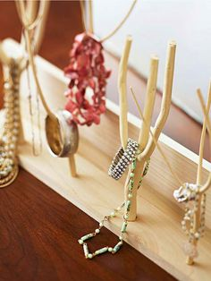 Turn small branches into inexpensive jewelry holders! Learn how here: http://www.bhg.com/decorating/do-it-yourself/accents/diy-accessories/?socsrc=bhgpin051513branchjewelryholder=19