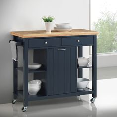Kitchen cart offers plenty of storage. Pull out garbage compartment. Offered in natural & navy blue. Includes 1 Kitchen Island Dimensions 41.25″W x 17.75″D x 35.00″H