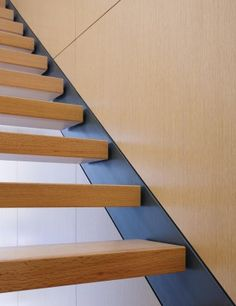 Excellent detailing with stringer set flush into wood paneled wall. Via residential architect by Brininstool Lynch