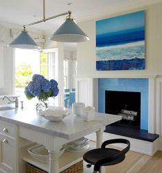 Ocean Blue for a Beach House Kitchen: http://www.completely-coastal.com/2016/04/ocean-art-paintings-photos-focal-point-decor-ideas.html Modern edge coastal kitchen with a large blue ocean photograph.