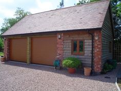 Double Garage Door on Brick/Wood Outbuilding