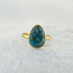 Copper Blue Turquoise Pear 10x14mm Micron Gold Plated 925 Sterling Silver Ring - #1092 ******************************************************* Please note that there will be slight changes in all the opaque stones in shade and texture in the actual product that you receive as these are made from natural gemstones. Stone quality or grade will be same.  Item Code: 1092  Metal: 925 Sterling Silver  Plating : Micron Gold Plated  Stone Detail : Copper Blue Turquoise, Pear, 10mm x 14mm…