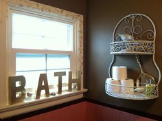 Bathroom decor. Love the BATH sign. Ditch the toilet paper being by the water though. Hahahah