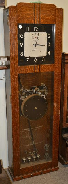 INTERNATIONAL BUSINESS MACHINE, Master Clock model 27 7; in oak case; height: 63…