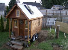 Dee Williams built her Tumbleweed tiny house several years ago from reclaimed building materials which helped keep the cost low with a final cost of around $10,000.
