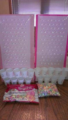 """Valentine's game plinko with conversation hearts. Easy and quick to make. Supplies: For grid: incompetech.com/graphpaper/squaredots/ 8 1/2"""" x 11"""" paper size 1 inch margin 8 point weight for dots .75 dots per cm (for conversation hearts) or .94 dots per cm (for Smarties candy made by Smarties Candy Company ) Bathroom Cups or plastic shot glasses  Translucent Push Pins Elmer's Foam Board (two pieces of 12""""x12""""; double-layer is required to cover sharp point of push pin)"""