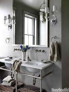 """Washstand With Towel Bars """"I love this washstand from Waterworks, because I can hang wet towels without having to have towel bars everywhere,"""" designer Barry Dixon says of the bathroom in a Washington, D.C. row house. Undermount basins and Etoile fixtures from Waterworks. Sconces by Crowder. Urban Smokebell lantern by Baker."""
