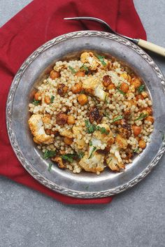 Israeli Couscous with cauliflower, candied walnuts and chick peas