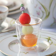 Fruit Shots  Cantaloupe, watermelon, and honeydew melon balls make a fun and refreshing treat when skewered and served in small cups filled with Honeybush Tea Simple Syrup.