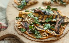 Vegetables soaked in a rich hummus marinade and then grilled make a superb topping for these tortilla pizzas, but you could also buy prepared grilled vegetables and just give them a sprinkling of balsamic vinegar.