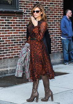 Eva Mendes blew kisses wearing a leopard-print dress, boots and rainbow-hued sunglasses outside the Late Show with David Letterman studios in NYC March 19.