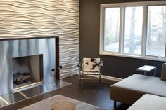 Textured gypsum wall board. This is one of my very favorite products for creating a textured wall. Check out Seattle-based Modulararts for a wide array of textures. You can create a single accent wall, as they did in this room.