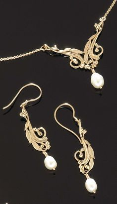 Carved laurel branches, available in 14k gold and sterling silver.  http://goldcrafterscorner.com