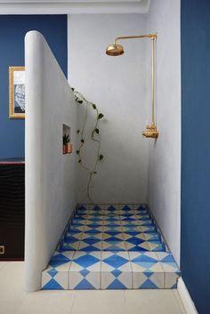 Idée décoration Salle de bain open shower   brass shower head   patterned tile floor   Greek inspired color pa