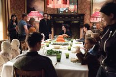 Director Tim Burton and star Eva Green chat between takes of the dinner scene