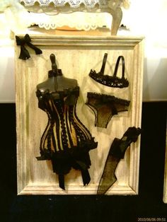 1 12th scale black and gold striped lingerie plaque on Etsy, $32.00