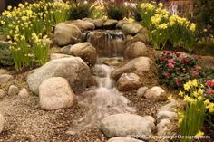 Pondless waterfall by aquascapedesigns.com