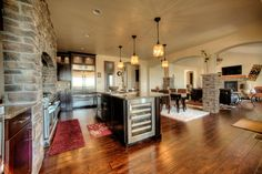Open plan with a center island and built in wine cooler, in a custom home by G.J. Gardner Homes