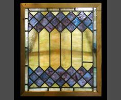 Deep blue diamonds contrasts the yellow-green glass that surrounds it in this wonderful stained glass window. See also item no. H143946.  Dimensions  23.5 in. W x 27 in. H x 1.75 in. D, glass 21 in. x 24.25 in. $825