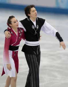Cathy Reed and Chris Reed of Japan leave the ice after competing in the team free ice dance figure skating competition at the Iceberg Skatin...