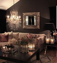 Cozy family room with gorg wall color. I love all of the candles and the light fixture. So inviting! #familyroom #candles