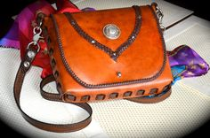 A personal favorite from my Etsy shop https://www.etsy.com/listing/235260482/angelfire-braided-messenger-bag-you-will