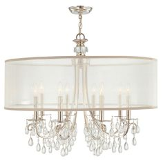 <p> Hampton Chandelier, available in a 5-light and 8-light version, features clear smooth oyster crystals with Silver silk shimmer shade and Polished Chrome finish. Also available in Antique Brass with Gold shimmer shade and English Bronze with Gold shimmer shade. 5-light is 24 inch diameter x 23 inches high and requires five 60 watt 120 volt B10 base candelabra incandescent lamps not included. 8-light is 32 inch diameter x 26 inches high and requires eight 60 watt 120 volt B10 base…