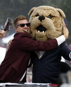 Jonathan Papelbon hugs ESPN College Gameday's Lee Corso, who was wearing the Bully mascot headgear after picking the Mississippi State Bulldogs to beat the Auburn Tigers.