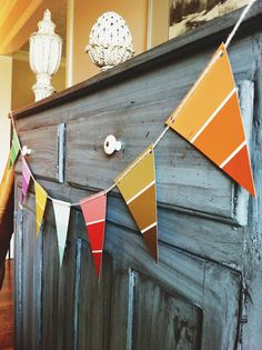 Paint Chip Party Banner| The Squirrel Next Door - add paper paint brushes underneath that spell Happy Birthday