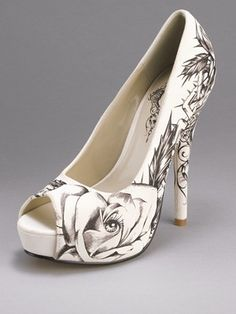 Totally want these for my wedding shoes now nothing like normal wedding shoes but i ADORE them.