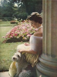 Princess Margaret in a very fetching pose with one of her Sealyhams