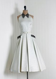 1950's dress - Stunning!  White dress accented at hip pockets & neckline in black.