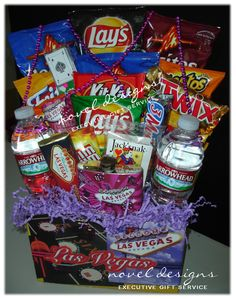 #LasVegas #Hotel #Delivery.  The Las Vegas Weekend Gift Basket for Her includes an assortment of savory snacks and sweet treats perfect for any Las Vegas celebration!  Also includes a keepsake flask, matching shot glass and party beads!  Perfect to have on hand in their hotel room!  Visit noveldesignsllc.com to place your order today!
