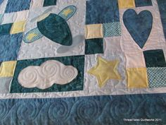 Another baby quilt...I think I have seen this one in the Keepsake Quilting catalog...she did a lovely job with her piecing AND her machine applique...