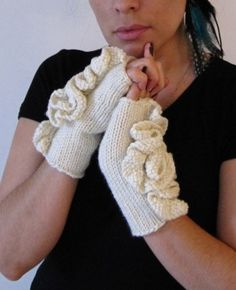 Roses cream fingerless gloves with a rosette on by PearlKnitPurl, $30.00