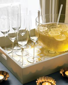 Use metallic paper to make a set of party-worthy tray liners for serving drinks. You can also use small tart tins from the kitchen to hold tea lights.