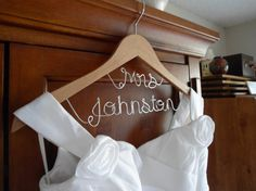 Check out this item in my Etsy shop https://www.etsy.com/listing/129308277/bridal-hanger-mrs-on-tophanger-two-lines