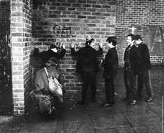 Schoolboys giggling while a soldier searches them in a street in the Ardoyne area of Belfast. (Photo by Keystone/Getty Images). 7th December 1971
